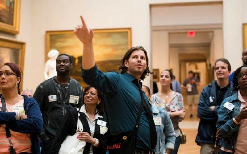 Image of a Museum Hack tour leader leading a group
