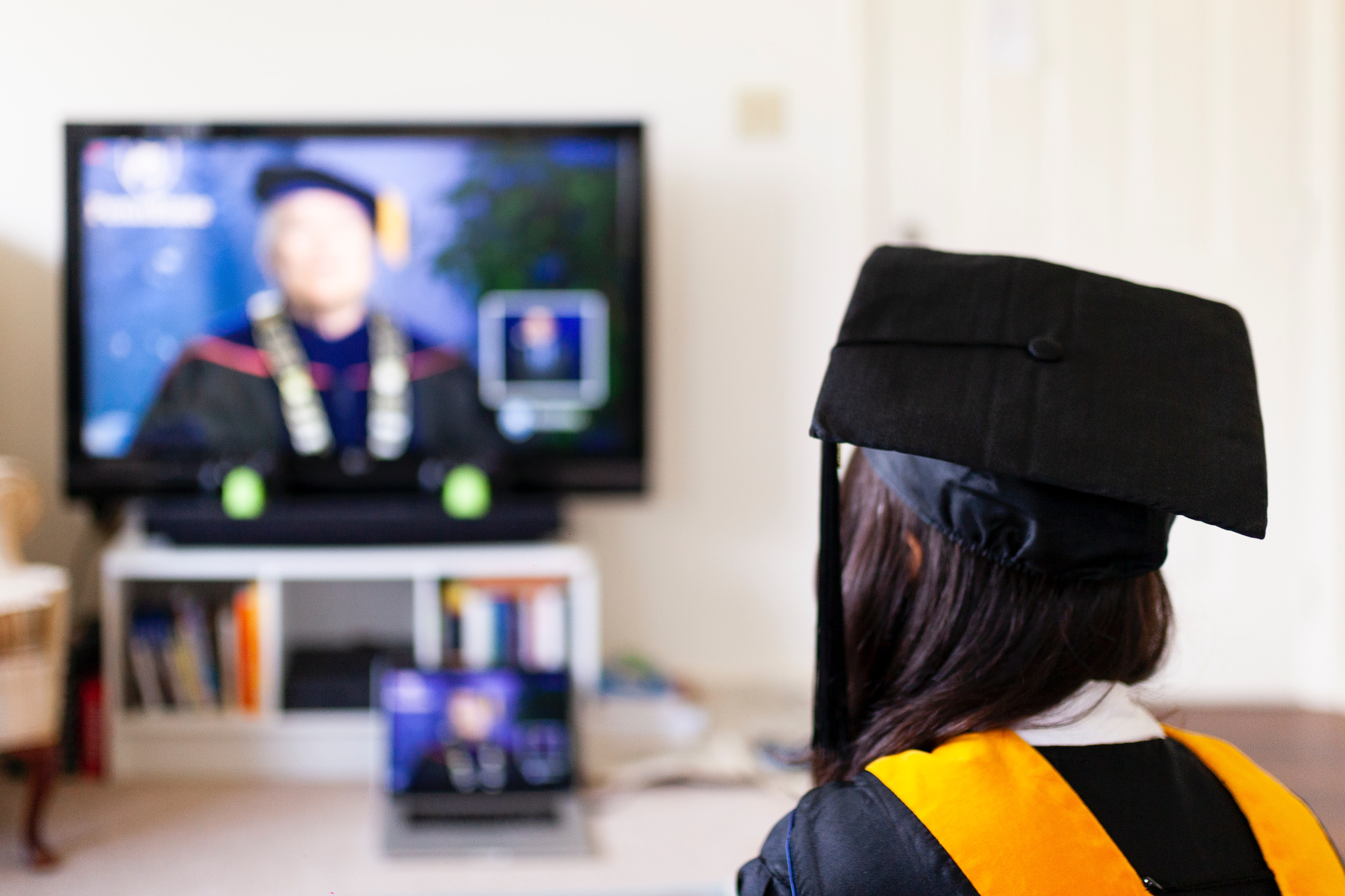 Image of a student watching graduation on TV