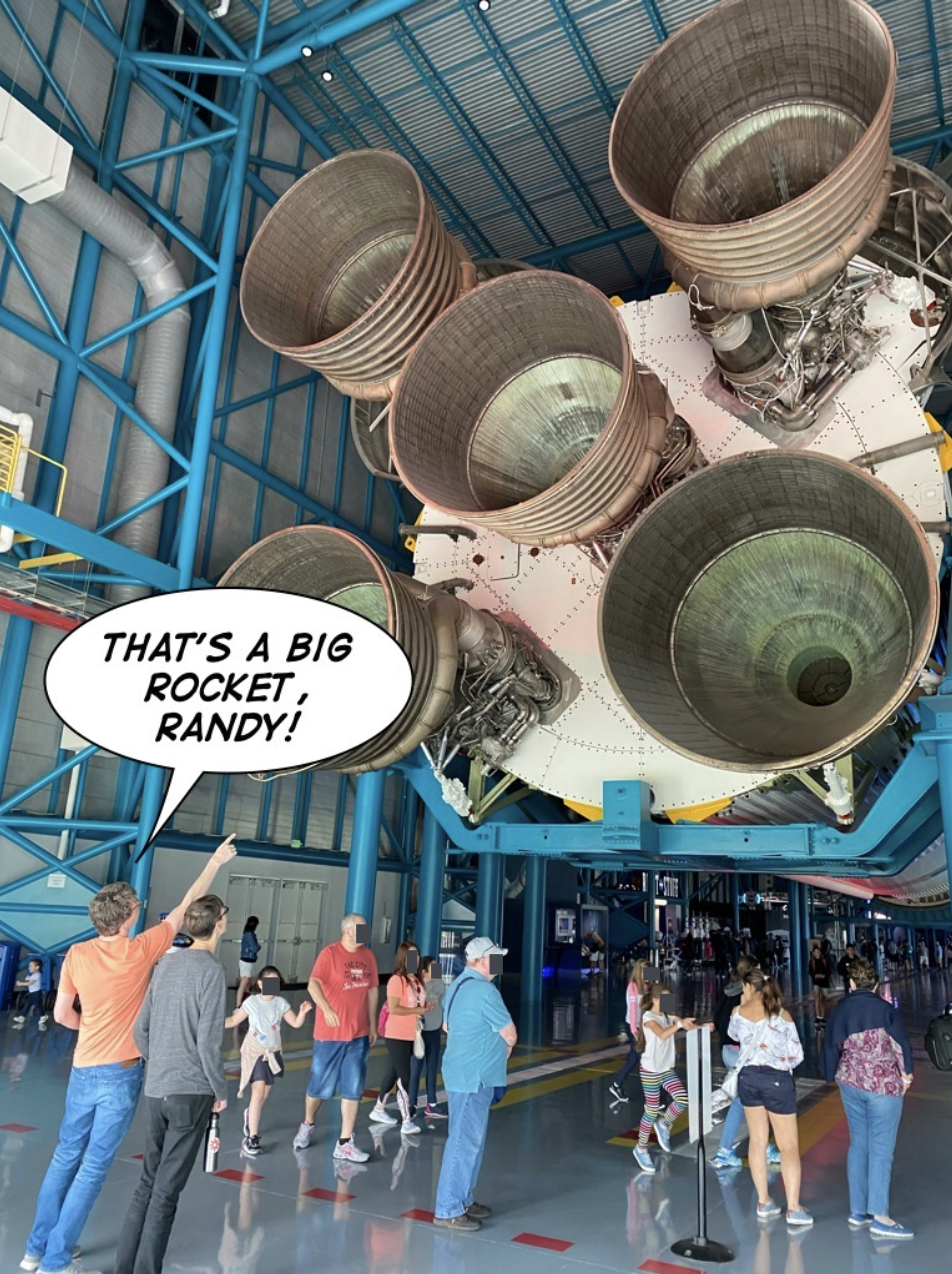 Bryan pointing at a rocket with a speech bubble that says That's a big rocket, Randy